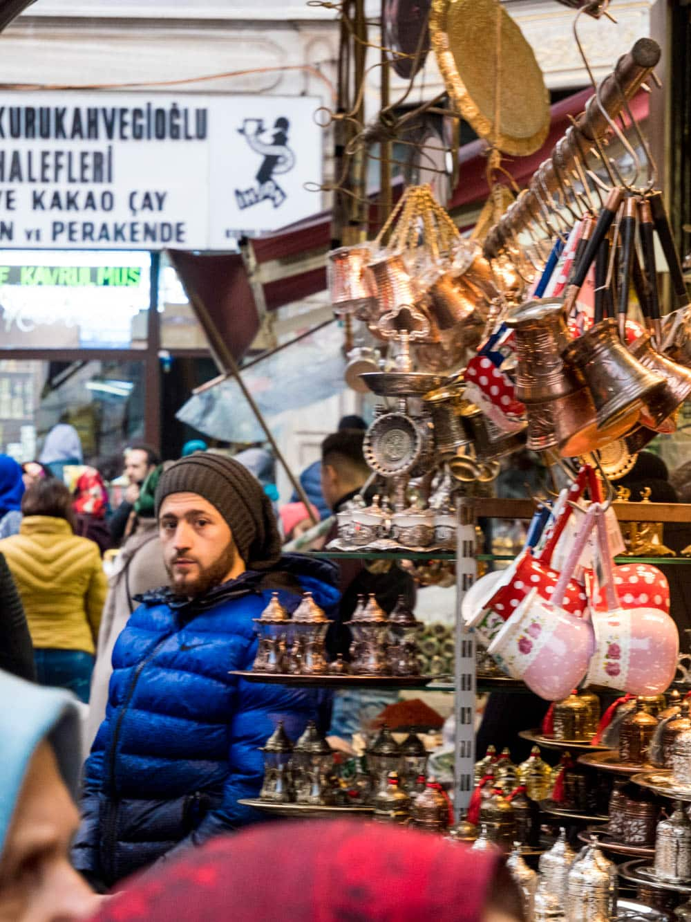 Trader at a stall for Turkish coffee and tea makers and accessories at the Istanbul spice market (Misir carsisi) / A kitchen in Istanbul