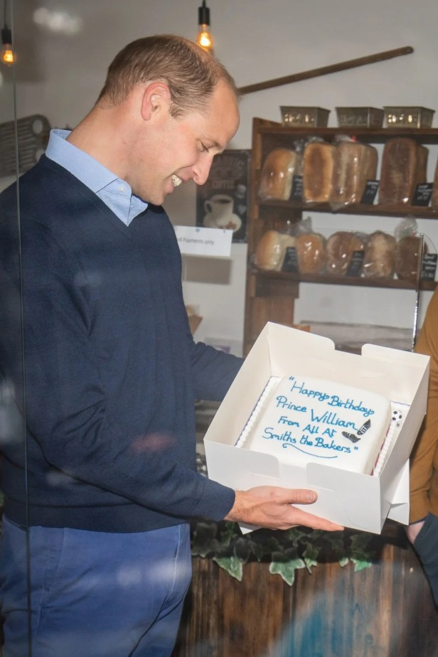 Prince William, Duke of Cambridge is presented with a birthday cake