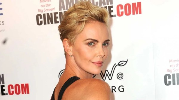 Charlize Theron with short hair at an awards, one of the celebrity allies in 2020