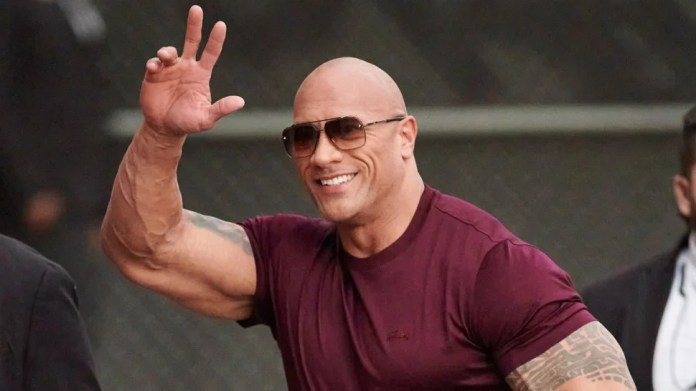 Dwayne Johnson Rips Down His Broken Front Gate | Entertainment Tonight