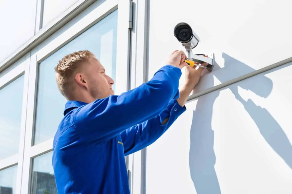 Installing Security Cameras on building- Etronics of Illinois