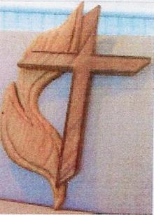 The cross and flame, the logo of The United Methodist Church, that Peter Etcheto carved for Rev. Sanford from wood salvaged from the balcony. Another one of Peter's cross and flame carving from the same wood hangs in our sister church in Cochabama, Boliva.