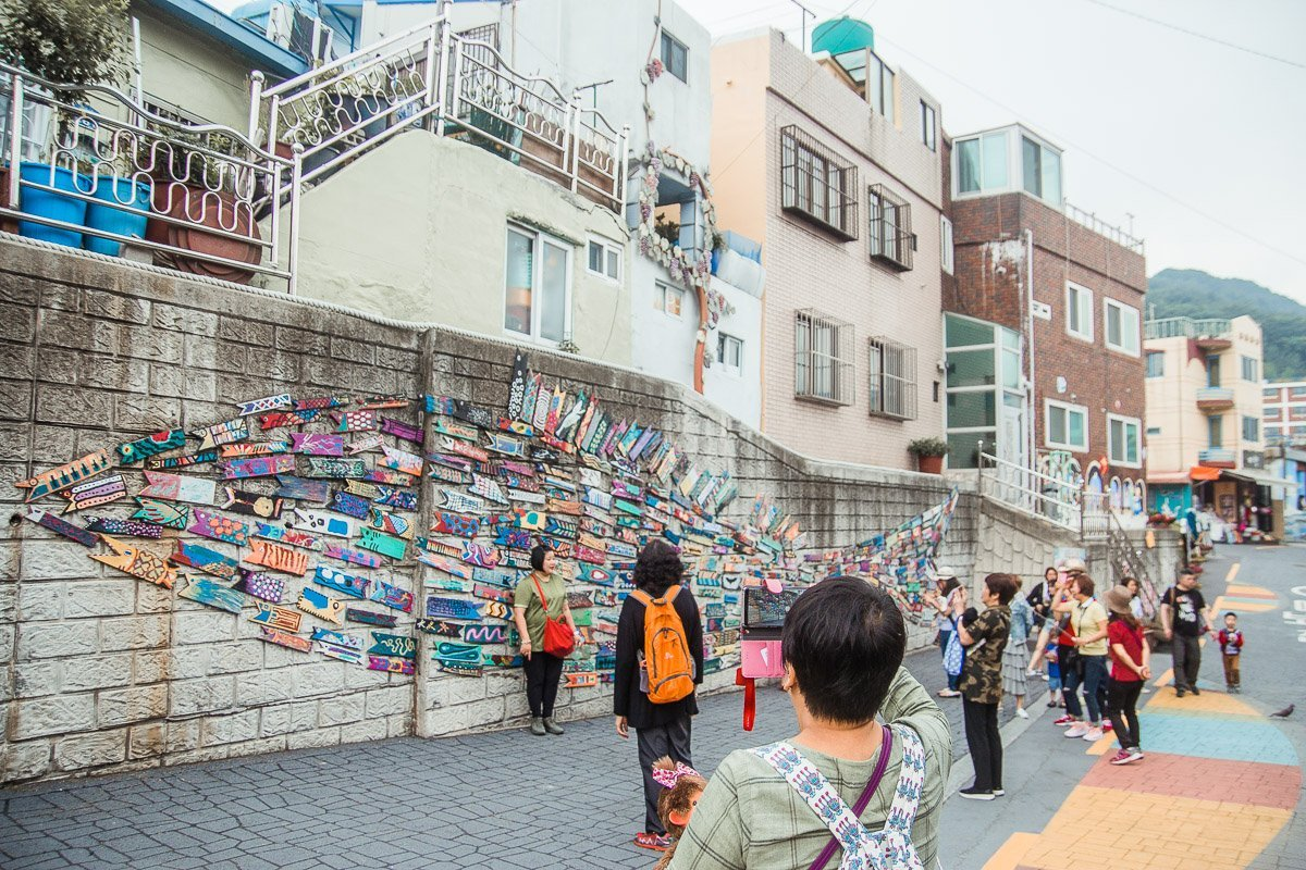 """Murals in Gamcheon Village On the same stretch, you will also see one of the famous murals in the village – """"Fish Swimming Through The Alley"""" by Jin Yeongseop."""
