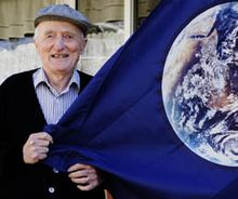 John McConnell in front of his home in Denver, Colorado with the Earth Flag he designed.