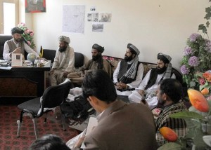 The Terezayi District governor (seated at desk) speaks with Mullah Shah Mohammed, Khost Ulema Council director, during a three-district visit promoting peace and government unity April 7. (Photo by U.S. Air Force Master Sgt. Matthew Lohr, Khost Provincial Reconstruction Team Public Affairs)