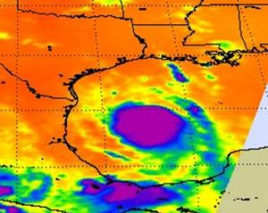 NASA's Aqua satellite passed over Tropical Storm Don at 8:17 UTC (4:17 a.m. EDT) on July 29. The infrared image revealed a large area of powerful, high thunderstorms with cold cloud tops (purple) surrounding the center where cloud temperatures were colder than -63 Fahrenheit (-52 Celsius).  Credit: NASA JPL, Ed Olsen