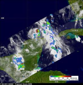 The TRMM satellite had a fairly good view of tropical Storm Don when it passed over on July 28, 2011 at 0609 UTC (1:09 a.m. CDT). A red tropical storm symbol shows the position, north of Mexico's Yucatan peninsula, where Don was located at that time. A TRMM rainfall analysis showed Don was dropping moderate to heavy rainfall (red) of up to 2 inches/50 mm per hour in the eastern side of the small storm. The yellow and green areas indicate moderate rainfall between .78 to 1.57 inches (20 to 40 mm) per hour.  Credit: NASA/SSAI, Hal Pierce