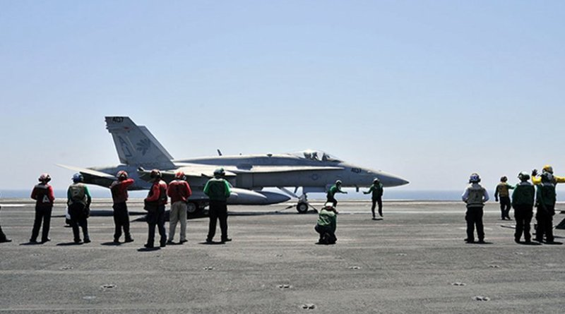 An American F/A-18C Hornet aboard USS George H.W. Bush prior to the launch of operations over Iraq. U.S. Navy photo by Mass Communication Specialist 3rd Class Margaret Keith