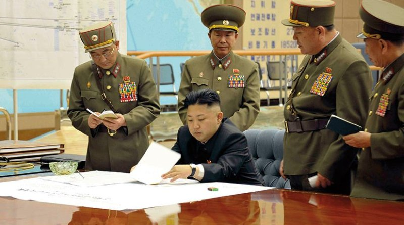 KimKim Jong-un sitting at desk in what appears a dedicated military operations room (Korean Central News Agency via NDU Press)