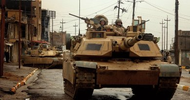M1 Abrams tanks maneuver in streets of Tall Afar, Iraq, as they conduct combat patrol (U.S. Air Force/Aaron Allmon)