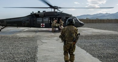 Servicemember trained as tactical critical care evacuation team nurse prepares for patient transfer mission at Forward Operating Base Orgun East, Afghanistan (U.S. Air Force/Marleah Miller)