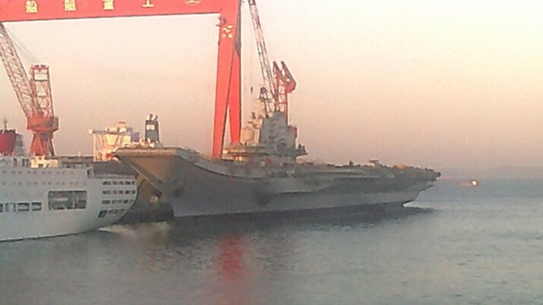 China's aircraft carrier the Liaoning (formerly the Russian ship Riga and subsequently renamed the Varyag before being sold to China) being refit in 2011. Photo Credit: Yhz1221, Wikipedia Commons.
