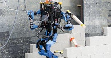 Team SCHAFT's robot, S-One, clears debris at DARPA's Robotics Challenge trials (DARPA/Raymond Sheh)