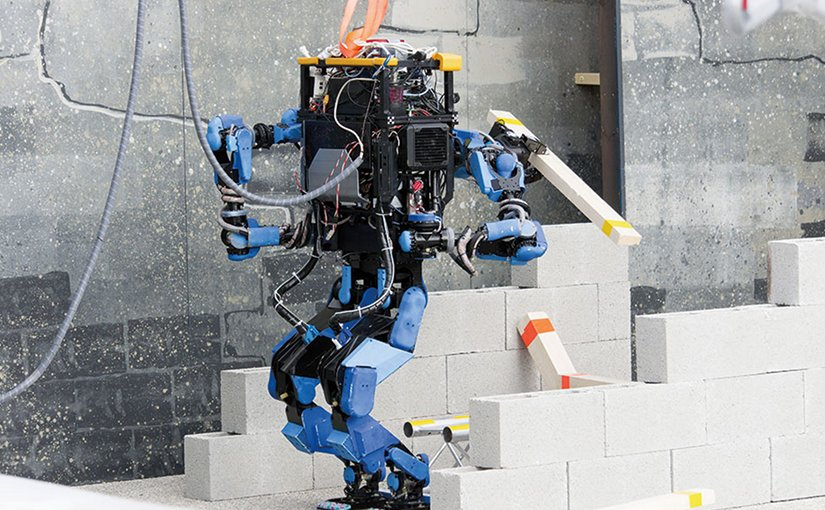 Team SCHAFT's robot, S-One, clears debris at DARPA's Robotics Challenge trials (DARPA/Raymond Sheh)