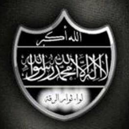 "Liwa Thuwar al-Raqqa's first emblem. On top: ""Allahu Akbar."" Beneath that: ""There is no deity but God, and Muhammad is the Messenger of God."""