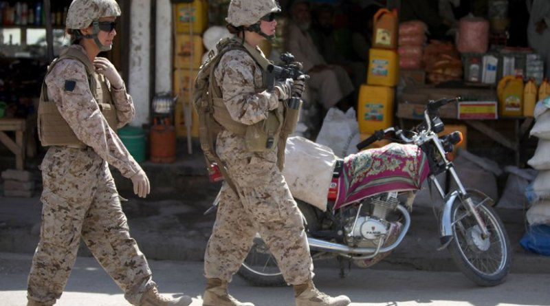 Two members of a US Marine Corps Female Engagement Team patrolling a town in Afghanistan. Photo Credit. US Marines, WIkipedia Commons.