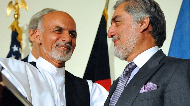 Afghanistan's Ashraf Ghani shakes hands with Abdullah Abdullah. Photo Credit: U.S. Department of State, Wikimedia Commons.