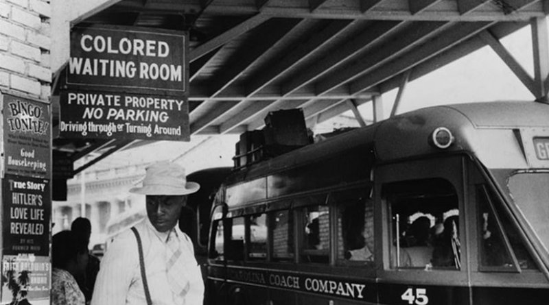 """Sign for the """"colored"""" waiting room at a bus station in Durham, North Carolina, 1940. Photo by Jack Delano, Wikipedia Commons."""