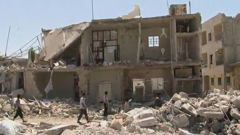 After aerial bombardment by the Syrian government of rebel-held areas of Azaz in Aleppo governorate. Photo Credit: Voice of America News: Scott Bob report from Azaz, Syria, Wikipedia Commons.