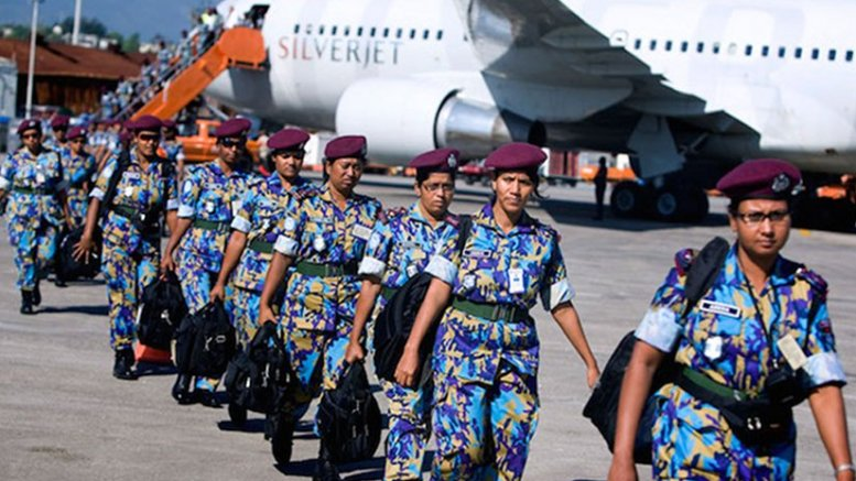 An all-female Formed Police Unit from Bangladesh, serving with the UN Stabilization Mission in Haiti, arrives in Port-au-Prince to assist with post-earthquake reconstruction. UN Photo/Marco Dormino
