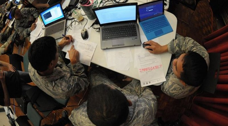 Hawaii Air National Guardsmen evaluate network vulnerabilities during the Po'oihe 2015 Cyber Security Exercise at the University of Hawaii Manoa Campus Center Ballroom, June 4, 2015. Po'oihe is part of the hurricane preparedness exercise Vigilant Guard/Makani Pahili 2015 hosted by U.S. Northern Command, the National Guard Bureau and the Hawaii Emergency Management Agency. Hawaii Air National Guard photo by Airman 1st Class Robert Cabuco