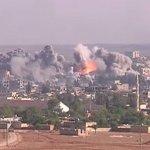 "Coalition airstrike on Islamic State position, October 2014. Photo Credit: Voice of America News: Scott Bobb reports from the Suruç, Turkey/ Kobane, Syrian border; ""Turkish Border Towns Hosting Thousands of Kobani Refugees"", Wikipedia Commons."