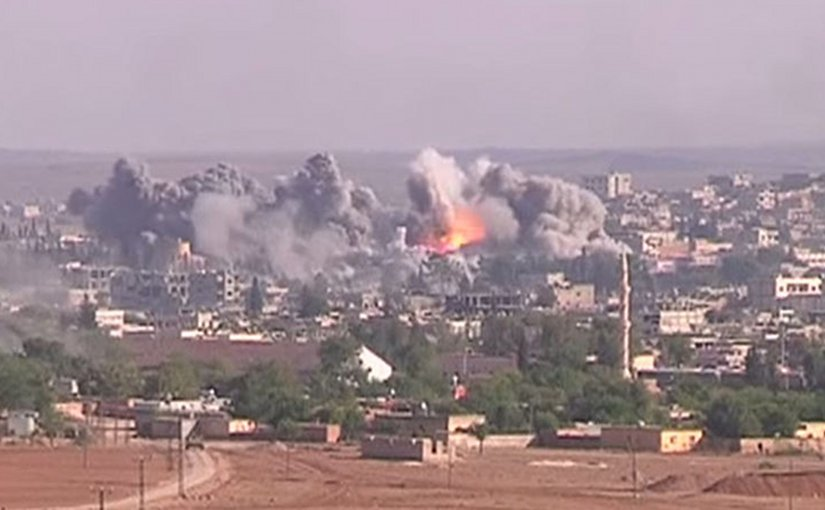 "Coalition airstrike on Islamic State position, October 2014. Photo Credit: Voice of America News: Scott Bobb reports from the Suruç, Turkey/ Kobane, Syrian border; ""Turkish Border Towns Hosting Thousands of Kobani Refugees"", Wikipedia Commons."