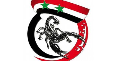 "Emblem of Liwa Khaybar, featuring the Syrian flag used by the regime and a scorpion (hence the inscription ""al-'Aqrab""- ""The Scorpion""- referring to the leader of the group)."