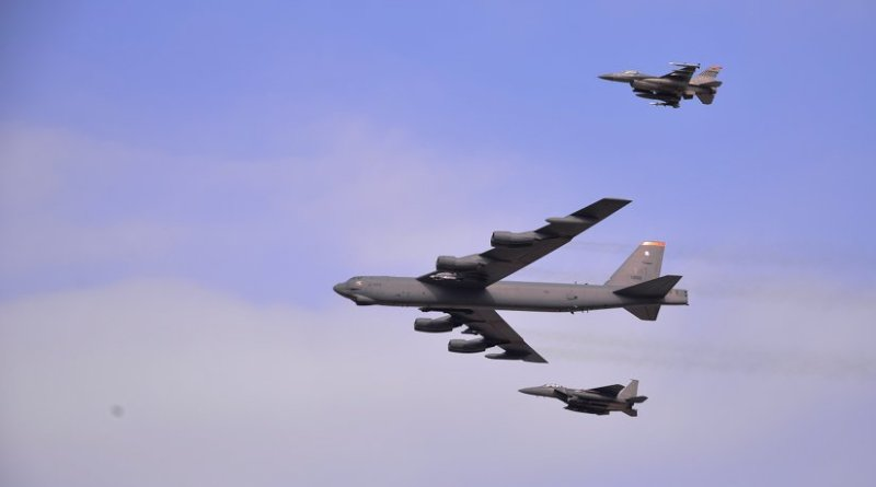 A U.S. Air Force B-52 Stratofortress from Andersen Air Force Base, Guam, conducted a low-level flight in the vicinity of Osan Air Base, South Korea, in response to recent provocative action by North Korea Jan. 10, 2016. The B-52 was joined by a South Korean F-15K Slam Eagle and a U.S. Air Force F-16 Fighting Falcon. The B-52 is a long-range, heavy bomber that can fly up to 50,000 feet and has the capability to carry 70,000 pounds of nuclear or precision guided conventional ordnance with worldwide precision navigation capability. (U.S. Air Force photo/Staff Sgt. Benjamin Sutton)