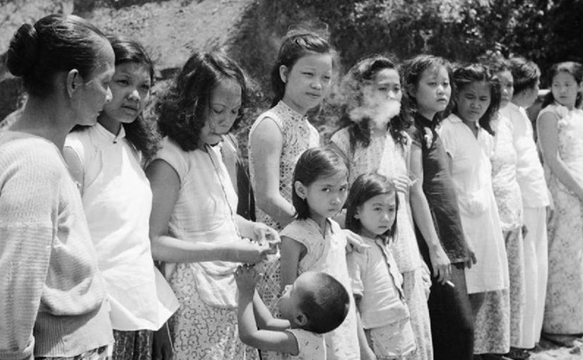 Chinese and Malayan girls forcibly taken from Penang by the Japanese to work as 'comfort girls' for the troops. Photo by Lemon A E (Sergeant), No 9 Army Film & Photographic Unit, Wikipedia Commons.