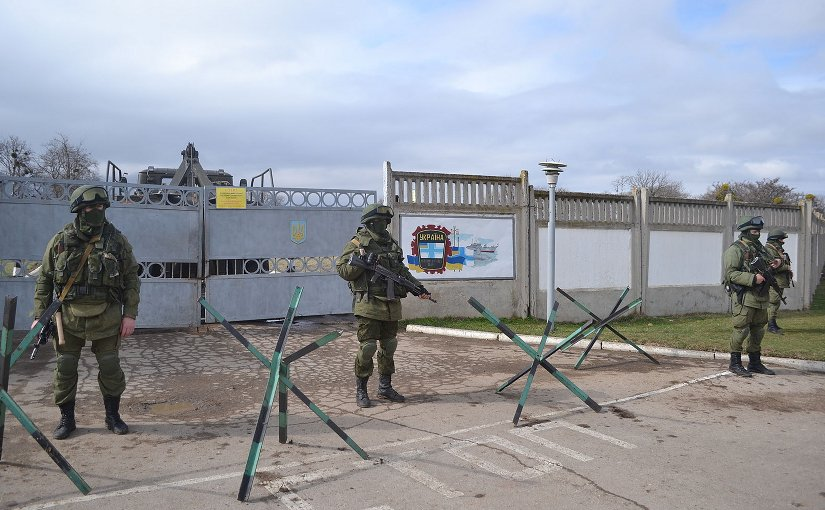 "Russia's ""Little green men"" armed with AK-74Ms blockading Perevalne military base, 25 kilometres south of Simferopol, 9 March 2014. Photo by Anton Holoborodko, Wikipedia Commons."