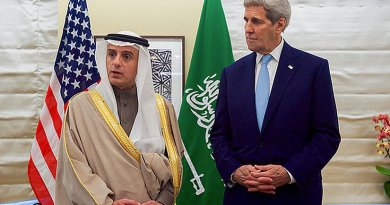 U.S. Secretary of State John Kerry listens as Saudi Arabian Foreign Minister Adel al-Jubeir addresses reporters after their meeting on January 14, 2015, at the Grosvenor House Hotel in London, U.K. Photo Credit: US State Department.