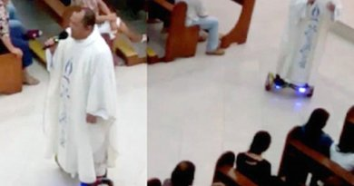 A screen grab from a video shows Father Albert San Jose on a hoverboard while singing to his congregation before the final blessing of the Christmas Eve Mass.