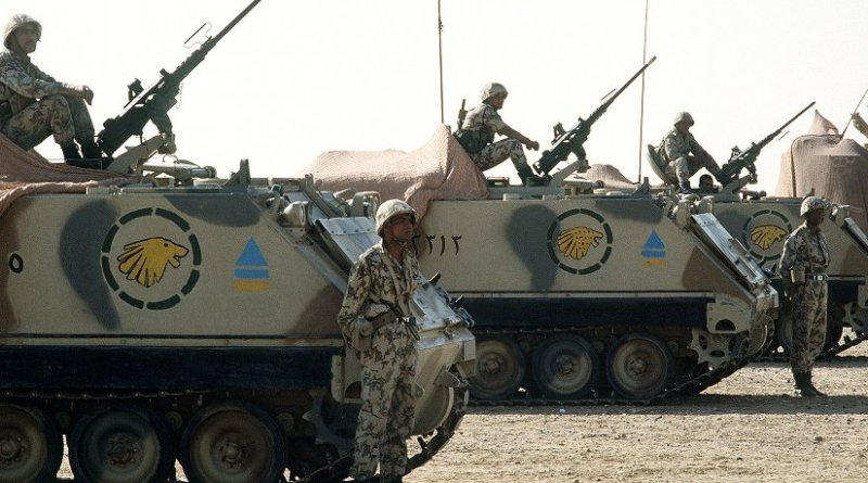Egyptian soldiers man M-2 .50-caliber machine guns atop M-113 armored personnel carriers during a demonstration for visiting dignitaries, part of Operation Desert Shield. Photo Credit: ech. Sgt. H. H. Deffner, Wikipedia Commons..