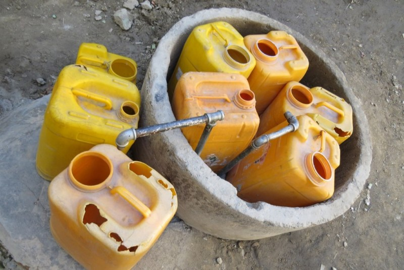 Containers at a well. Photo by Dr. Hakim.