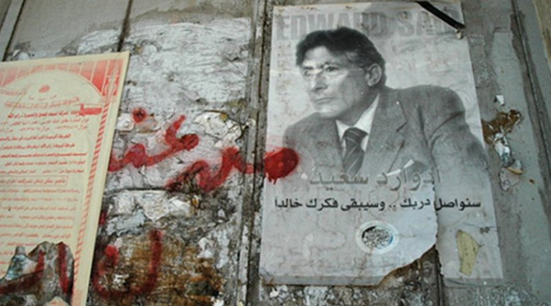 In Memoriam Edward Wadie Saïd: a Palestinian National Initiative poster at the Israeli West Bank wall. Photo taken by Justin McIntosh, Wikipedia Commons.