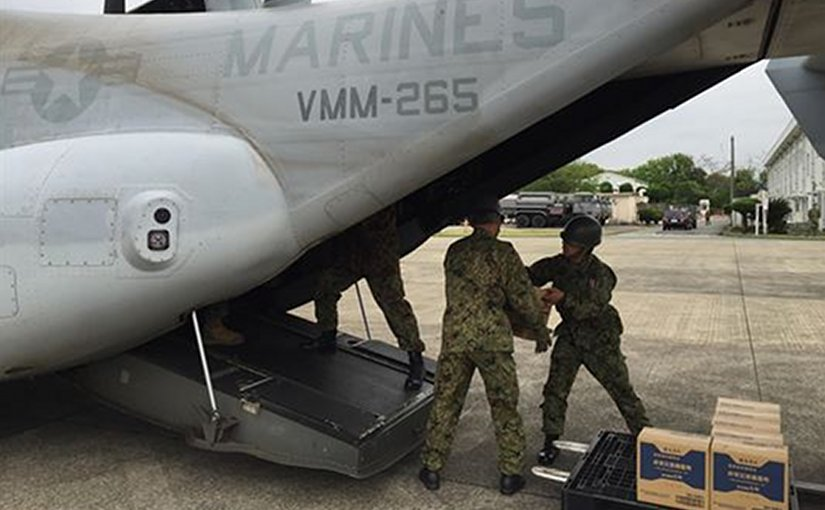 Japan Self-Defense Forces service members load earthquake relief items onto an MV-22B Osprey belonging to Marine Medium Tilt rotor Squadron 265, 31st Marine Expeditionary Unit at Marine Corps Air Station, Iwakuni, Japan, April 18, 2016. American 31st Marine Expeditionary Unit members were in Iwakuni to support relief efforts in response to the earthquakes that struck the island of Kyushu. Marine Corps photo by Capt. Jennifer Giles