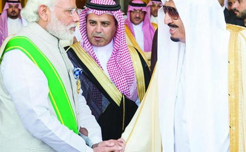 Saudi Arabia's King Salman greets Indian Prime Minister Narendra Modi after conferring the highest civilian award, the King Abdul Aziz Medal, on him in Riyadh. Photo Credit: SPA