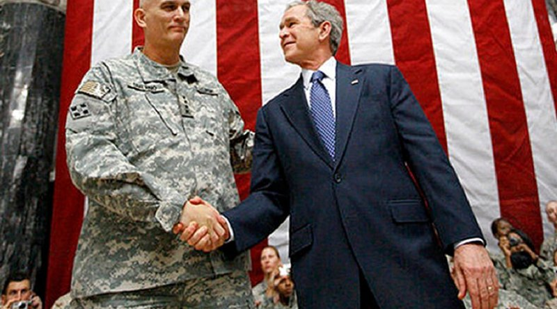US President George W. Bush stands on stage with U.S. Army Gen. Ray Odierno, commander, Mulitnational Force Iraq, after Bush addressed U.S. military and diplomatic personnel at Al Faw Palace on Camp Victory in Baghdad, Dec. 14, 2008. White House photo by Eric Draper