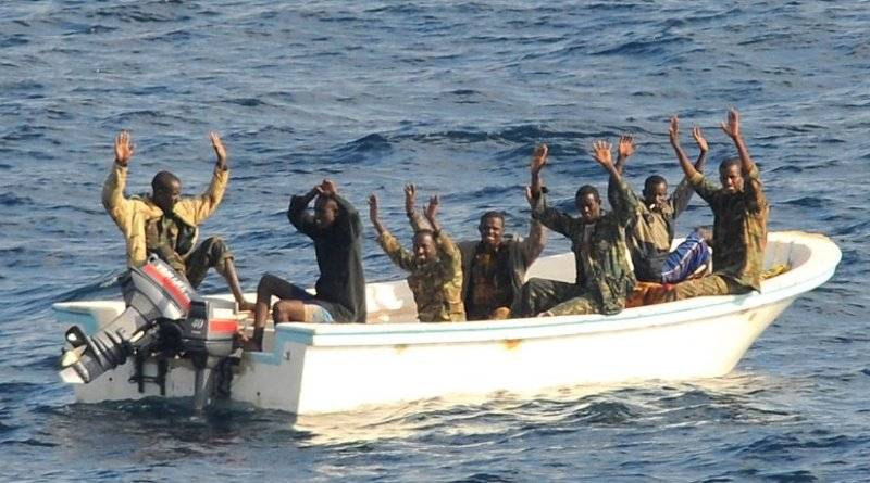 Suspected pirates wait for members of the counter-piracy operation to board their boat. Photo: US Navy/Jason R Zalasky