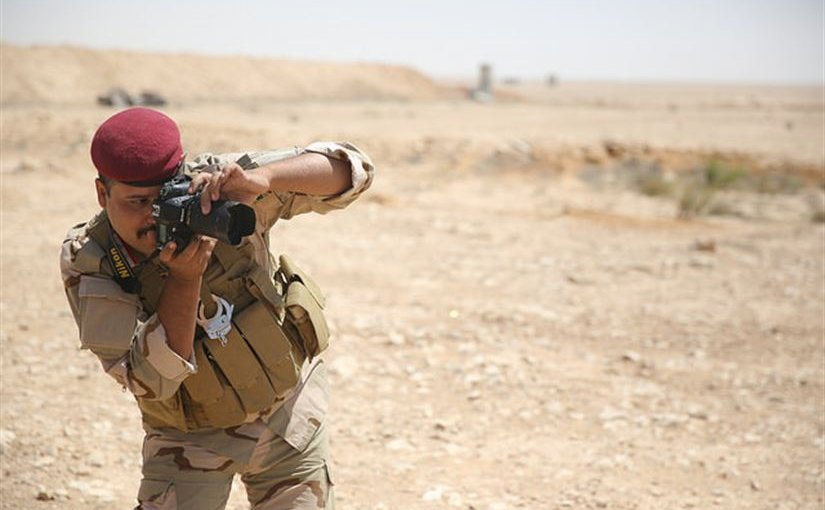 An Iraqi soldier practices using a camera during media cell training at Al Asad Air Base, Iraq, June 27, 2015. Through advise-and-assist and building-partner-capacity missions, Combined Joint Task Force Operation Inherent Resolve spokesman Army Col. Steve Warren told Pentagon reporters May 18, 2016, the multinational coalition has trained more than 31,000 Iraqi forces. Marine Corps photo by Cpl. Jonathan Boynes