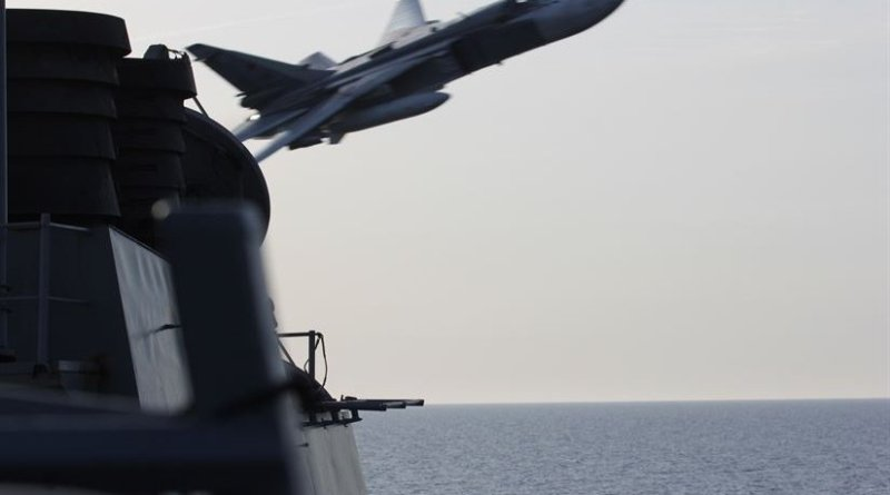 A Russian Sukhoi Su-24 attack aircraft makes a very low-altitude pass by the guided-missile destroyer USS Donald Cook in international waters in the Baltic Sea, April 12, 2016. The USS Donald Cook, forward-deployed to Rota, Spain, is conducting a routine patrol in the U.S. 6th Fleet area of operations in support of U.S. national security interests in Europe. Navy photo