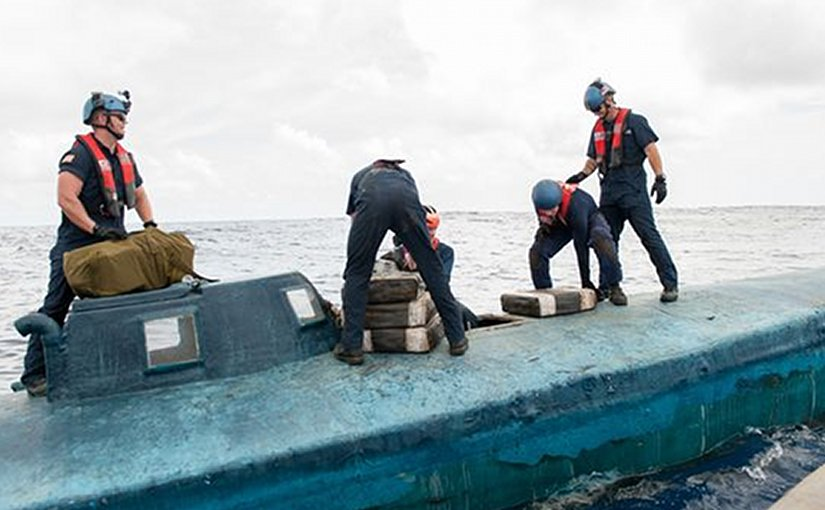 A US Coast Guard Cutter Stratton boarding team seizes cocaine bales from a self-propelled semi-submersible interdicted in international waters off the coast of Central America. The Coast Guard recovered more than 6 tons of cocaine from the 40-foot vessel. (Photo: MC2 LaNola Stone/Coast Guard)