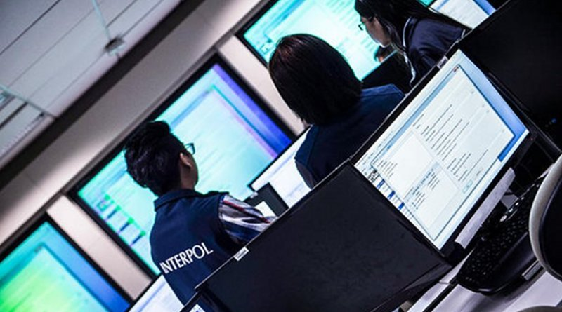 Interpol online fraud investigation team. Photo Credit: INTERPOL.