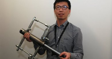Ruichen Wang with the prototype shock absorber.
