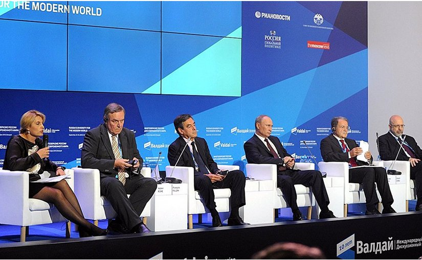 At a meeting of the Valdai International. Discussion Club. Left to right: Editor-in-Chief of RIA Novosti Svetlana Mironyuk, former German defence minister Volker Ruehe, former French prime minister Francois Fillon, Vladimir Putin, former Italian prime minister Romano Prodi, and President of the US Centre for the National Interest Dimitri Simes. Credit: Kremlin.ru