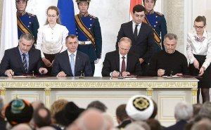 Agreement on the accession of the Republic of Crimea to the Russian Federation signed. The document bears the signatures of President of the Russian Federation Vladimir Putin, Chairman of the State Council of the Republic of Crimea Vladimir Konstantinov, Prime Minister of the Republic of Crimea Sergei Aksyonov and Chairman of the Coordinating Council for the establishment of the Sevastopol municipal administration Alexei Chaly. Photo Credit: Kremlin.ru