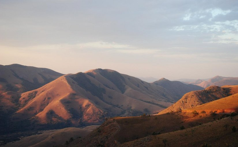 Today the Barberton Mountains in northeastern South Africa are covered by rocky grasslands; these hills are made of some of the oldest rocks on Earth (3.2 - 3.5 billion years old). At 3.2 billion years ago a shallow ocean covered most of this area, where rivers draining into this ocean provided favorable environment for life to start colonizing the flood planes. Credit Sami Nabhan/FSU Jena