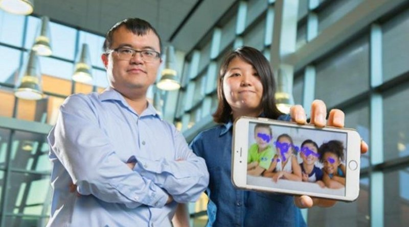 From left to right, Wenyao Xu, University at Buffalo assistant professor of computer science and engineering, and undergraduate Kun Woo Cho, show a smartphone with the autism tracking software they are developing. The purple blotches show where a child looks. This photo indicates no autism spectrum disorder. Credit Credit: Douglas Levere.