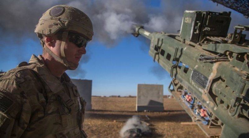 A soldier assigned to Charlie Battery, 1st Battalion, 320th Field Artillery Regiment, observes as an M777 A2 howitzer fires in support of Iraqi forces during the Mosul offensive at Platoon Assembly Area 14, Iraq, Dec. 7, 2016. Charlie Battery conducted the fire mission in support of Combined Joint Task Force Operation Inherent Resolve, the global coalition to defeat ISIL in Iraq and Syria. Army photo by Spc. Christopher Brecht